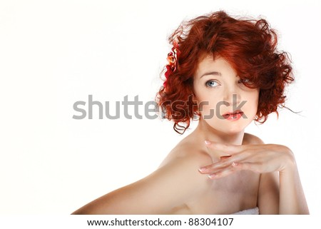 Portrait of beautiful redheaded girl, cosmetics, isolated on a white background