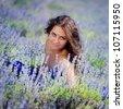 Portrait of beautiful romantic woman in fairy field of lavander - stock photo