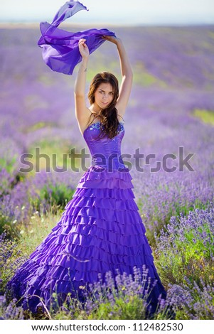 Portrait of beautiful romantic woman in fairy field of lavender - stock photo