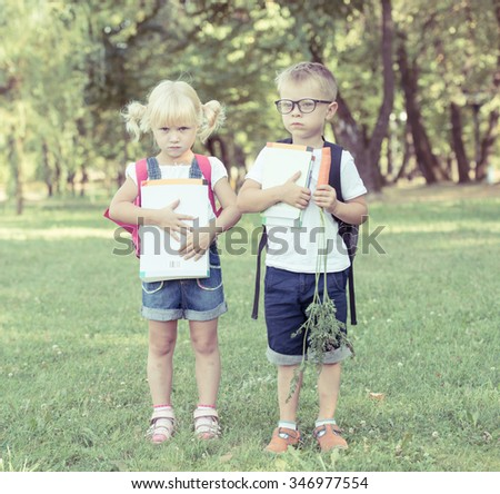 Portrait of Beautiful school boy and girl looking very happy outdoors at the day time. Concept school theme. - stock photo