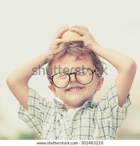 Portrait of Beautiful school boy looking very happy outdoors at the day time. Concept school theme. - stock photo
