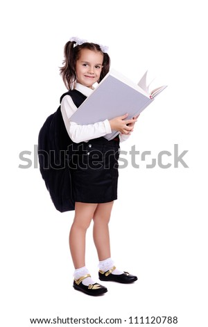 Portrait of beautiful schoolgirl holding a big book over white background
