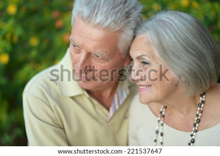 Portrait of beautiful senior couple outdoors on the walk