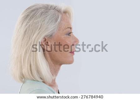 Portrait of beautiful senior woman profile view - stock photo