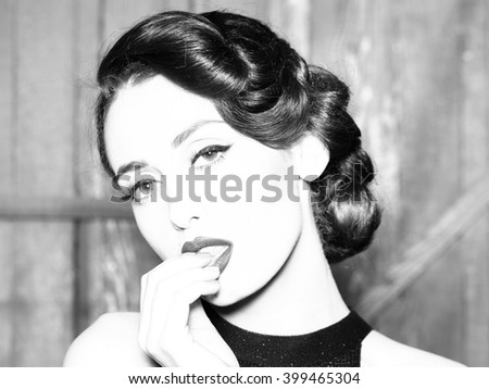 Portrait of beautiful sensual sexy fashionable retro elegant young adult woman with classic hairstyle and red lips indoor on wooden background, horizontal picture