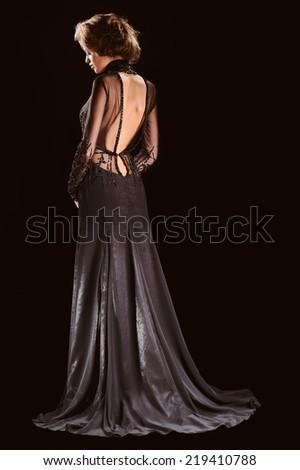 Portrait of Beautiful Sensual Woman in Fashion Black Dress - stock photo