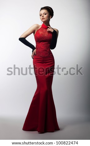 Portrait of Beautiful Sensual Woman in Fashion Red Dress. Christmas Sales and Shopping concept - stock photo