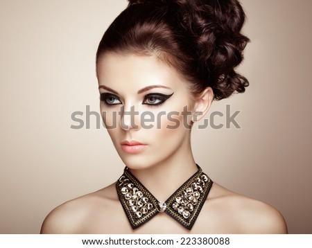 Portrait of beautiful sensual woman with elegant hairstyle. Diamond collar. Perfect makeup. Fashion photo - stock photo