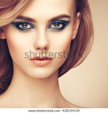 Portrait of beautiful sensual woman with elegant hairstyle. Perfect makeup. Beauty fashion. Eyelashes. Lips. Cosmetic Eyeshadow - stock photo