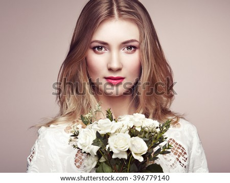 Portrait of beautiful sensual woman with elegant hairstyle.  Perfect makeup. Blonde girl. Beauty fashion. Flowers - stock photo