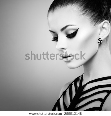 Portrait of beautiful sensual woman with elegant hairstyle.  Perfect makeup. Fashion photo