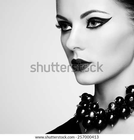 Portrait of beautiful sensual woman with elegant hairstyle.  Perfect makeup. Fashion photo. Black and White