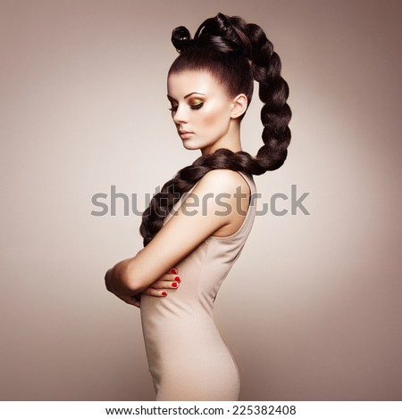 Portrait of beautiful sensual woman with elegant hairstyle.  Perfect makeup. Girl pigtailed. Fashion photo - stock photo
