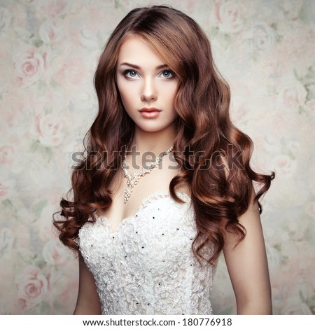 Portrait of beautiful sensual woman with elegant hairstyle. Wedding dress. Fashion photo - stock photo
