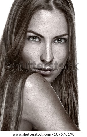 Portrait of beautiful sensual woman with freckles - stock photo