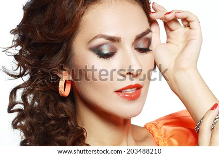 Portrait of beautiful sensual woman with long brown hair and bright make-up  - stock photo