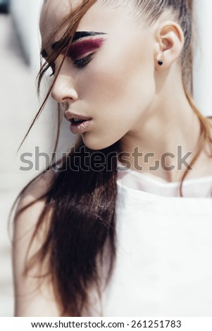 Portrait of beautiful sensual young girl close-up, outdoors, the concept of health and beauty