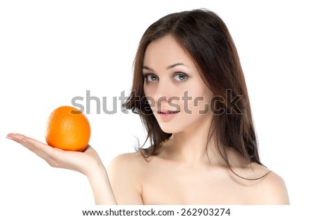 Portrait of beautiful sexy brunette girl on a white background with orange - stock photo