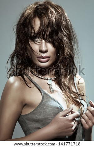 Portrait of beautiful sexy brunette woman looking at camera.