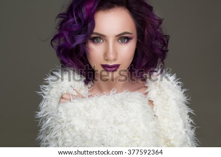 Portrait of beautiful sexy fashion model with violet hair and make up