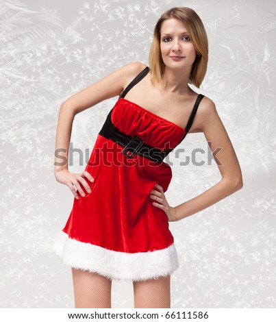 Portrait of beautiful sexy girl wearing santa claus clothes on frost pattern