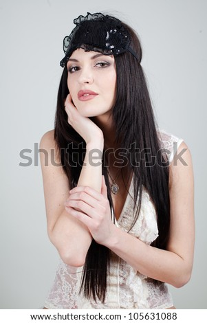 portrait of beautiful sexy girls dressed in white underwear with a bandage for sleeping. She poses in the studio on a white background. - stock photo