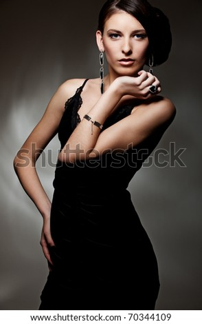 portrait of beautiful sexy model in black dress - stock photo