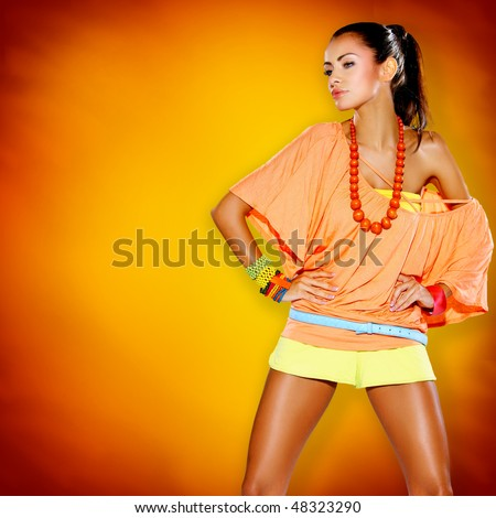 Portrait of beautiful sexy woman colorful background - stock photo