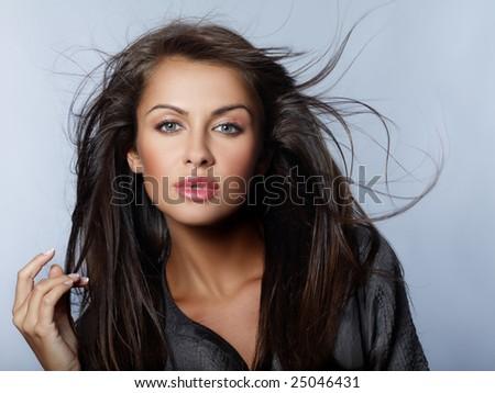 Portrait of beautiful sexy woman on blue - stock photo