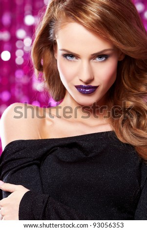 Portrait of beautiful sexy woman on purple background