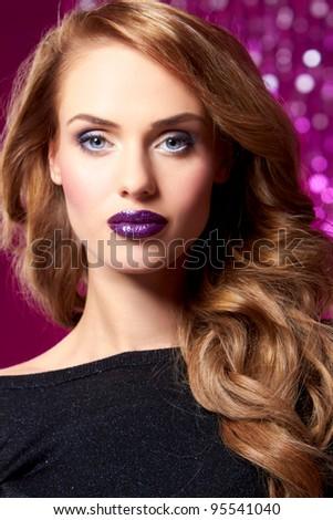 Portrait of beautiful sexy woman on purple background - stock photo