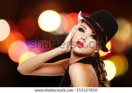 Portrait of beautiful sexy woman with bright red lips and fashionable hat - stock photo