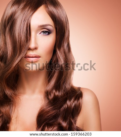 Portrait  of beautiful sexy woman with long red hairs. Closeup face  with curly hairstyle - studio