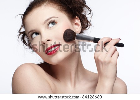 portrait of beautiful slavonic brunette girl making up - stock photo