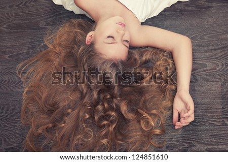 Portrait of beautiful sleeping girl with curly hair