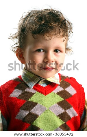 Portrait of beautiful small boy with funny curly hair