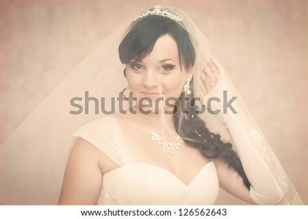 portrait of beautiful smiley bride with a veil,. Vintage photo. wedding dress.