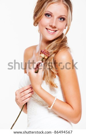 portrait of beautiful smiley bride with rose - stock photo