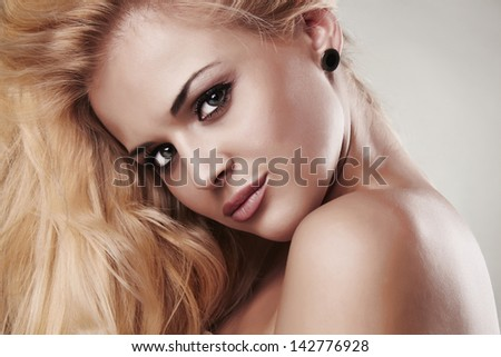 Portrait of beautiful smiling blond woman