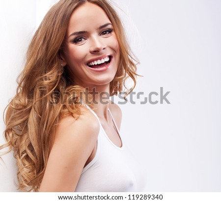 Portrait of beautiful smiling blonde woman