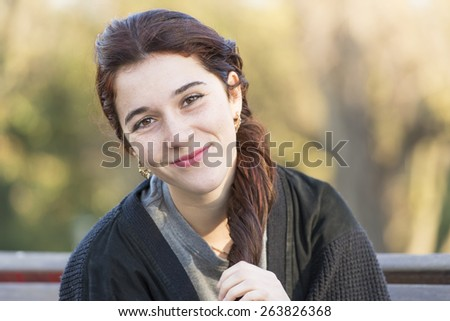 Portrait of beautiful smiling caucasian young woman, outdoor. - stock photo