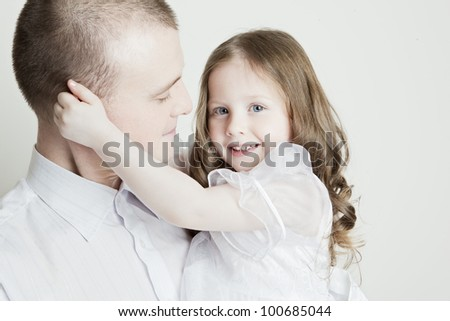 Portrait of beautiful smiling family: father and daughter on a white background - stock photo