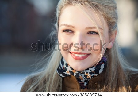 Portrait of beautiful smiling girl. Outdoor shoot - stock photo