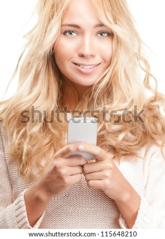 Portrait of beautiful smiling girl with modern cell phone in hands isolated on white background. Young happy woman making call or typing text message. Social person. Communication and technology