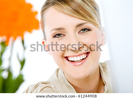 Portrait of beautiful smiling happy blond business woman, looking at camera - stock photo