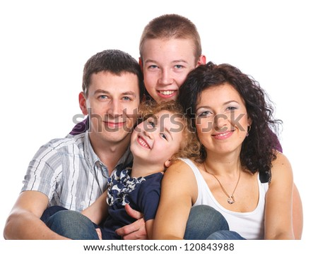 Portrait of beautiful smiling happy family of four - isolated over a white background - stock photo
