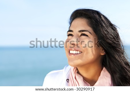 Portrait of beautiful smiling hopeful native american girl