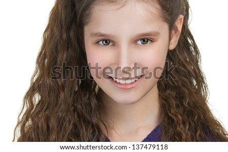 Portrait of beautiful smiling schoolgirl with dark curly hair, isolated on white background.