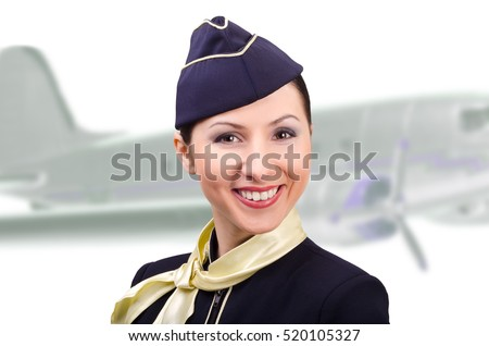 Portrait of beautiful smiling stewardess on a background the airplane