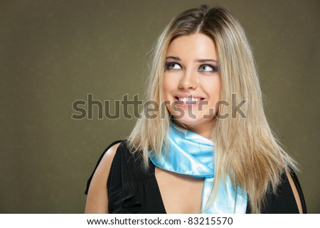Portrait of beautiful smiling woman,  isolated on gray